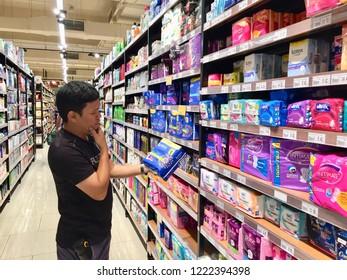 Penang, Malaysia - November 5, 2018 : View of a man looking at a Kotex brand of sanitary pad for sale inside Jaya Supermarket at Gurney Paragon