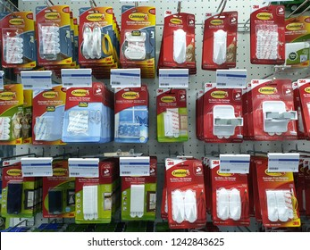 PENANG, MALAYSIA - OCT 26, 2018 : Command brand Picture Hanging Strips and Hooks by 3M company on store shelf. 3M is the general public primarily known for the Post-it Notes and Scotch Tapes.