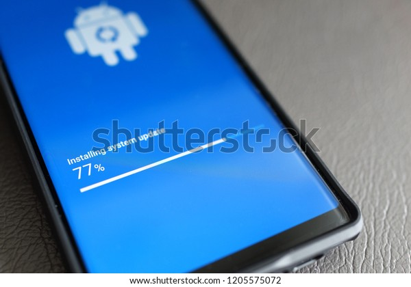 PENANG, MALAYSIA - OCTOBER 2, 2018 : Android phone installing system update in progress. Android is a mobile operating system developed by Google.