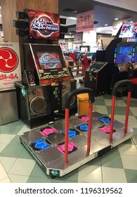 Penang, Malaysia - October 6, 2018 : Perspective view of Dance Dance Revolution Super Nova dancing arcade game at Aeon Queensbay
