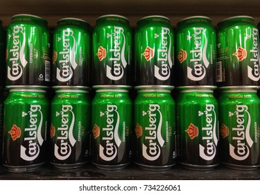 PENANG, MALAYSIA - SEPTEMBER 19, 2017 : Carlsberg cans beer on store shelf. The Carlsberg is a Danish brewing company founded in 1847, headquarters located in Copenhagen,Denmark
