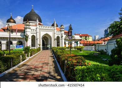 Penang, Malaysia - September 3, 2013: Front entrance of Kapitan Keling Mosque, a prominent Islamic historic center built by Indian muslim traders in 19th century in historic George Town, Penang.