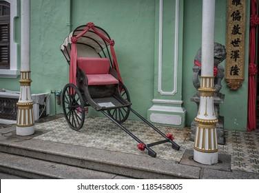 Penang, Malaysia.  September 9, 2018: Vintage chinese trishaw park at the corridor of the Pinang Peranakan Mansion museum.