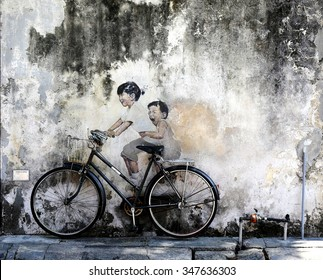 PENANG, MALAYSIA-DEC 03: Little Children on Bicycle is a mural painted by London-trained artist Ernest Zacharevic, in conjunction with the 2012 George Town Festival.