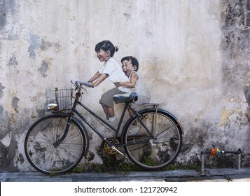 PENANG, MALAYSIA-DEC 8: General view of a mural 'Little children on a bicycle'� painted by Ernest Zacharevic in Penang on Dec.8, 2012. The mural is one of the 9 murals painted by him in early 2012.
