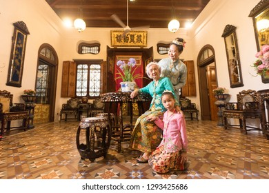 Penang, Malaysia-January, 22 2019: The  beautiful model with Chinese traditional clothing and house can be found in Peranakan Mansion in Penang. Image contains certain grain or noise and soft focus