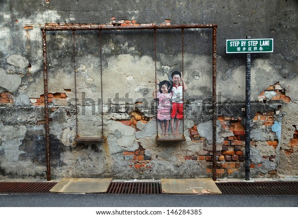 PENANG, MALAYSIA-JULY 6: Street Mural tittle 'Children on the Swing' painted by Louis Gan in Penang on July 6, 2013. It was painted in conjunction with the 2012 George Town Festival.