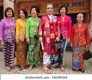 PENANG, MALAYSIA-JULY 6: Women of Nyonya Baba ethnic pose on street during the 5th Anniversary George Town World Site Heritage Celebrations in Penang on July 6, 2013.