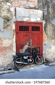PENANG, MALAYSIA-MAY 12: General view of a mural 'Boy on a Bike' painted by Ernest Zacharevic in Penang on May 12, 2014. The mural is one of the 9 murals paintings in early 2012.