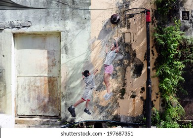 PENANG, MALAYSIA-MAY 12: Street Mural tittle 'Children Playing Basketball' painted by Louis Gan in Penang on May 12, 2014. It was painted in conjunction with the 2012 George Town Festival.