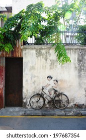 PENANG, MALAYSIA-MAY 12: Street Mural tittle 'Little Children on a Bicycle' painted by Ernest Zacharevic in Penang on May.12, 2014. It was painted in conjunction with the 2012 George Town Festival.