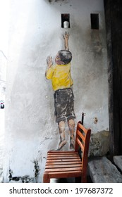 PENANG, MALAYSIA-MAY 12: Street Mural entitled 'Reaching Up' painted by Ernest Zacharevic in Penang on May 12, 2014. It was painted in conjunction with the 2012 George Town Festival.