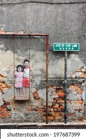 PENANG, MALAYSIA-MAY 12: Street Mural tittle 'Children on the Swing' painted by Louis Gan in Penang on May 12, 2014. It was painted in conjunction with the 2012 George Town Festival.