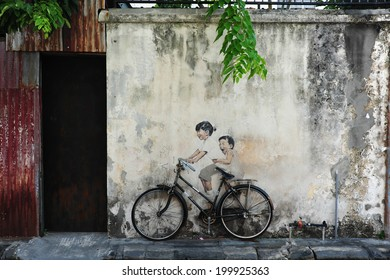 PENANG, MALAYSIA-MAY 12  Street Mural tittle  Little Children on a Bicycle  painted by Ernest Zacharevic in Penang on May 12, 2014  It was painted in conjunction with the 2012 George Town Festival