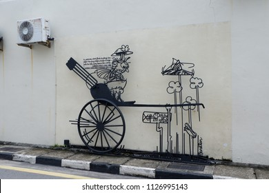 """PENANG, MALAYSIA-May 27,2018 : General view of steel-rod Sculpture """"Cannon Hole"""" based on caricature by cartoonist Tang Mun Kian in Penang ."""