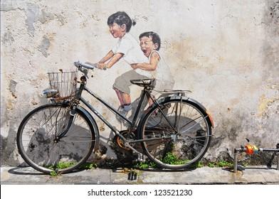 PENANG, MALAYSIA-NOV 24: General view of a mural 'Little children on a bicycle' painted by Ernest Zacharevic in Penang on Nov 24, 2012. The mural is one of the 9 murals paintings in early 2012.