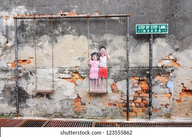 PENANG, MALAYSIA-NOV 24: General view of a mural 'Children on the Swing'� painted by Louis Gan in Penang on November 24, 2012. This art work can be found at Chulia Street .