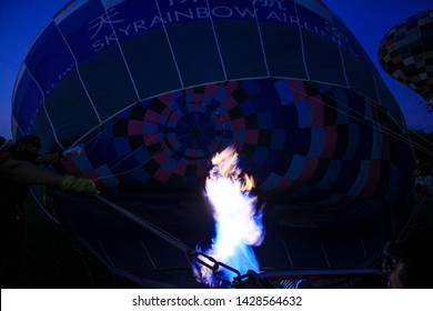 Penang Polo ground, Malaysia, February 10th, 2019. Beautiful hot air balloon, bright burning fire flame from gas burner equipment, during dawn hours