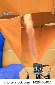 Penang Polo ground, Malaysia, February 10th, 2019. The crew members are inflating the hot air towards the inner part of a balloon envelope before flying off.