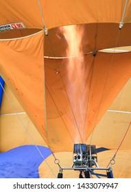 Penang Polo ground, Malaysia, February 10th, 2019. The crew is inflating the hot air towards the inner part of a balloon envelope before flying off.