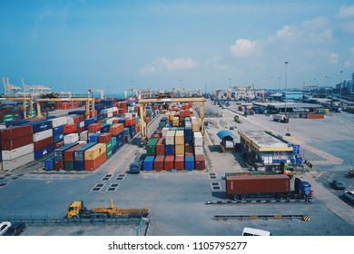 Penang Port, Malaysia - Dec 13, 2017 : Container yard  of Penang, Malaysia port, Logistics truck transport for export and import many container with clear blue sky day.