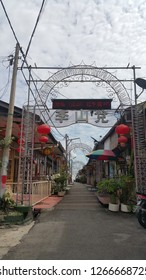 PENANG,MALAYSIA – DECEMBER 20,2018 : Front gate of Tan jetty ,one of the six clan jetties in George Town. It is located between Chew Jetty and Lee Jetty.