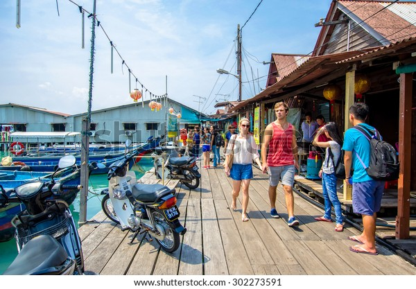 Penang,Malaysia - July 17,2015 : Chew Jetty which is one of the UNESCO World Heritage Site in Penang.People can seen walking and exploring around it.