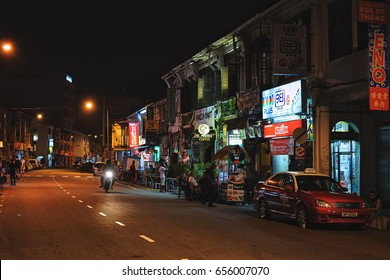 PENANG/MALAYSIA - MARCH 6, 2017: Night life on the famous Lebuh Chulia street in the historical center of George Town on Penang island, Malaysia