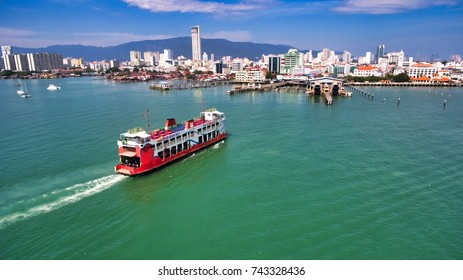 Penang,Malaysia - Oktober 2017 : Ferry carring passengers cruising between Malaysia mainland and Penang Island.It is one of Penang tourism attractions.