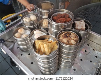 Penang,Malaysia-August 14, 2018 : Penang's Dim sum on stainless bowls for customers to choose. Traditional Chinese-Malaysian Cuisine. Penang. Malaysia.