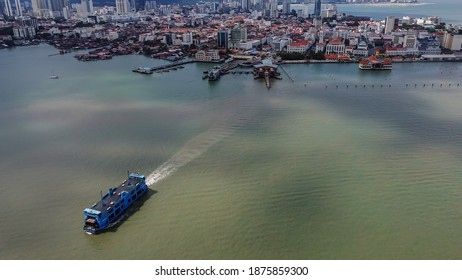 Penang,Malaysia-December 16th,2020:A blue ferry were seen cruising away from the terminal in Georgetown.Penang Ferry will be discontinued starting 31st December 2020.