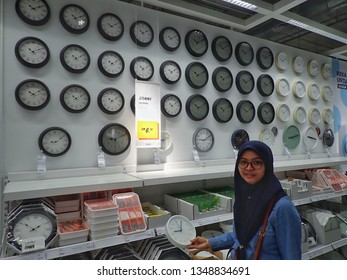 Penang,Malaysia-Mac 23rd,2019:A female visitor is looking at the wall clock section in the newly open Ikea Batu Kawan, Penang.Ikea Batu Kawan is the 4th Ikea outlet in Malaysia