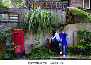 Penang,Malaysia-November 20th,2018:Two women posing at the Monkey cup attraction here in Penang Hill. This place is about 20minutes walk from the main area of Penang Hill.