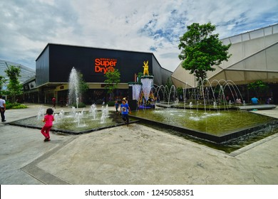 Penang,Malaysia-November 22nd,2018:Couple of kids playing around the fountain in the Penang Design Village outlet mall. This is the first outlet mall here in Batu Kawan, Penang.
