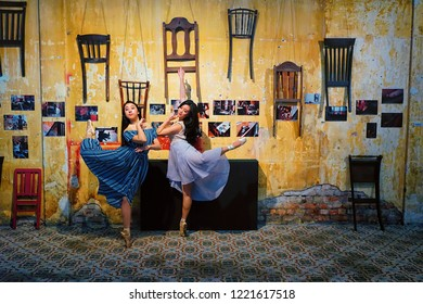 Penang,Malaysia-October 28th,2018:Two beautiful girls making balet dancing pose in Hin Bus Depot market.This market operates every Sunday from morning till evening.