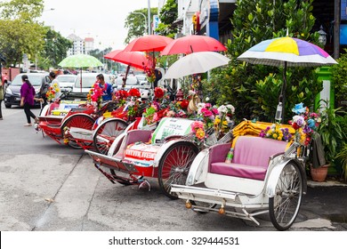 PENANG,MALAYSIA-Sep 5 ,2015: Vintage  Trishaw stop beside road for service traveller in Penang ,Malaysia.