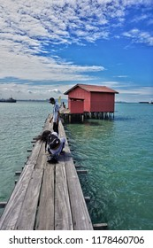 Penang,Malaysia-September 10th,2018:Local tpurist taking photo at the middle of the pathway at Tan Jetty. Tan jetty is one of the famous and heritage site in Penang.