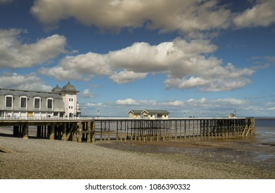 PENARTH, CARDIFF, WALES - MAY 2018: The pier in Penarth near Cardiff, Wales, at low tide, The seafront is on the Bristol Channel, which has one of the highest tidal ranges in the world.