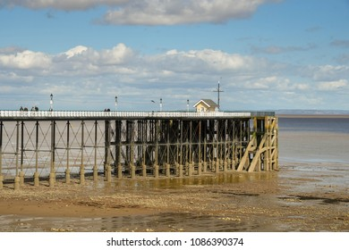 PENARTH, CARDIFF, WALES - MAY 2018: End of the pier in Penarth near Cardiff, Wales, at low tide, The seafront is on the Bristol Channel, which has one of the highest tidal ranges in the world.