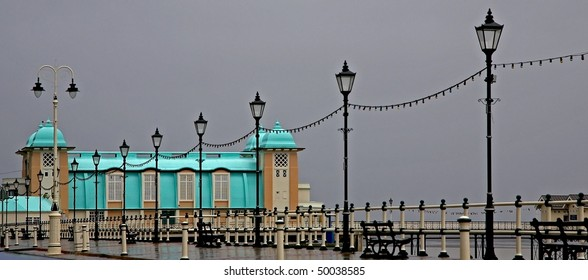 Penarth pier lit up against a grey sky
