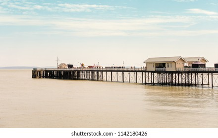 Penarth, United Kingdom -  July 20, 2018: Production team shooting scenes for a movie on Penarth Pier in summer 2018.