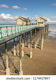 PENARTH, VALE OF GLAMORGAN - AUGUST 2018: Wide angle view of the pier at Penarth, Wales, at low tide.