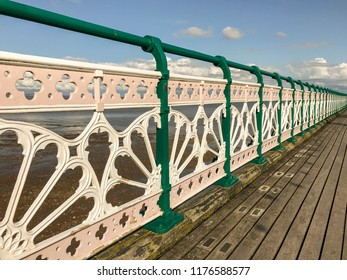 PENARTH, VALE OF GLAMORGAN - AUGUST 2018: Close up view of painted decorative railings on the Victorian pier in Penarth, Wales.