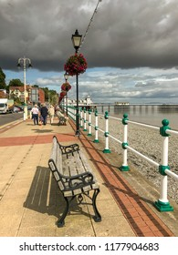PENARTH, VALE OF GLAMORGAN - AUGUST 2018: Esplanade in Penarth, Wales, with a large dark cloud in the sky.