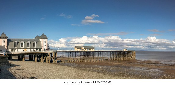 PENARTH, VALE OF GLAMORGAN - AUGUST 2018:Panoramic view of the Victorian pier and pavilion  in Penarth, Wales, at low tide.