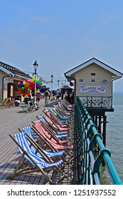 Penarth, Vale of Glamorgan / Wales UK - 7/19/2018 : Filming of 'Six minutes to Midnight'. Penarth Pier, S.Wales. The pier recreates  the pre-WWII era with coloured balloons and striped deck chairs