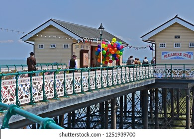 Penarth, Vale of Glamorgan / Wales UK - 7/19/2018 : Filming of 'Six minutes to Midnight'. Penarth Pier, S.Wales. The pier recreates  the pre-WWII era with coloured balloons and striped deck chairs.
