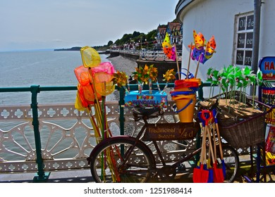 Penarth, Vale of Glamorgan / Wales UK - 7/19/2018 : For filming of 'Six minutes to Midnight', Penarth Pier was decorated to recreate the pre-WWII era. These props show seaside toys of the era for sale