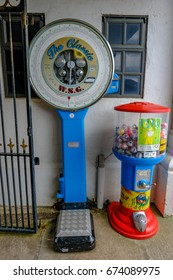 Penarth, Wales - May 21, 2017: WSG coin operated weighing machine on Penarth Pier, standing by the wall.