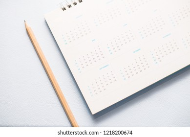 Pencil blue calendar on white tone.